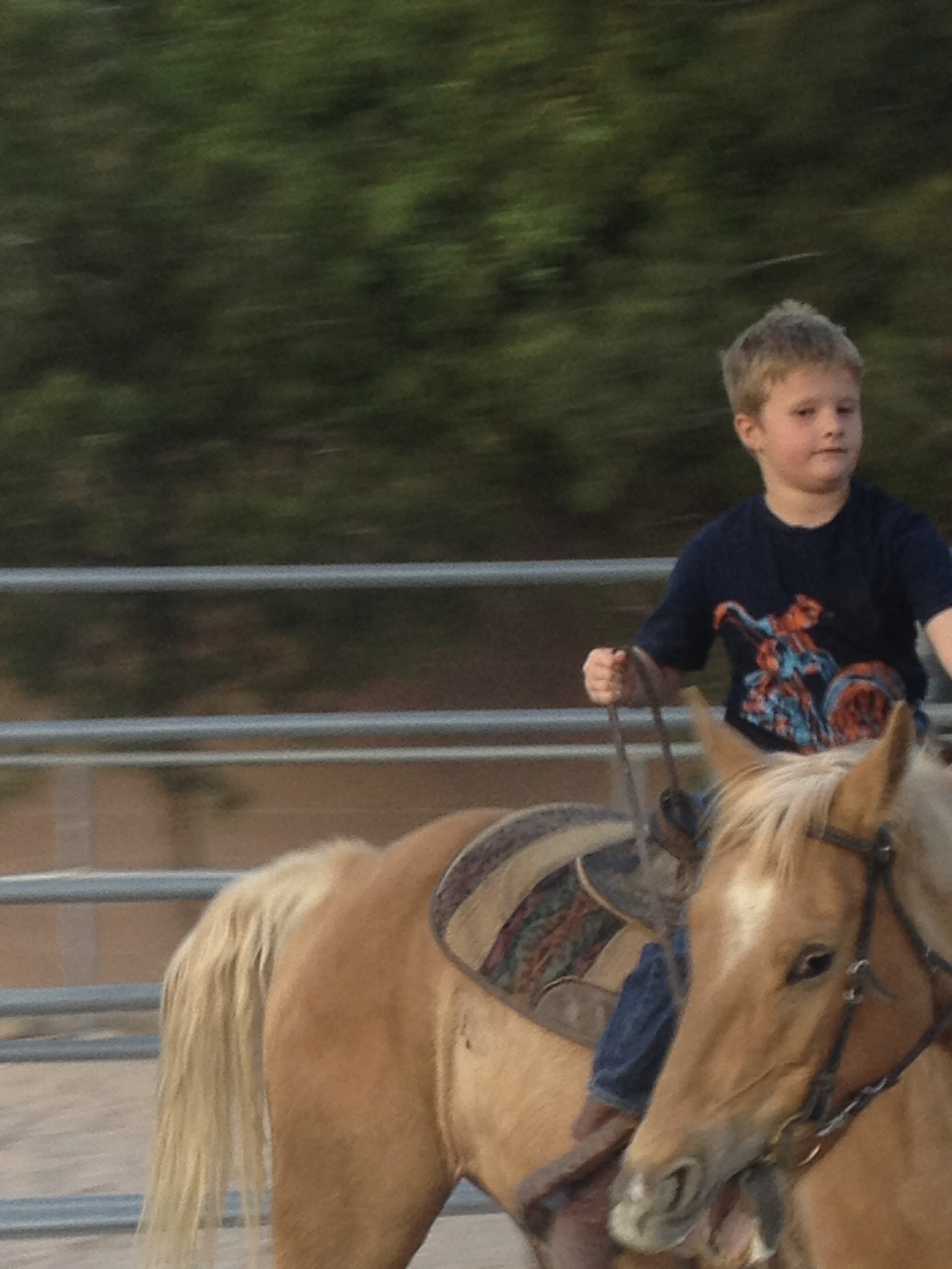 Gary Fales' son Jacob Fales riding Coco Motion the horse